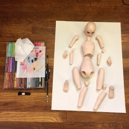 Body laid out to be reassembled and blushed with pastels.